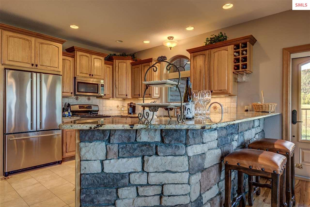 Stone work is carried through to the breakfast bar