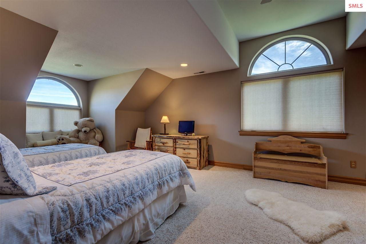 East guest bedroom is spacious with large view win