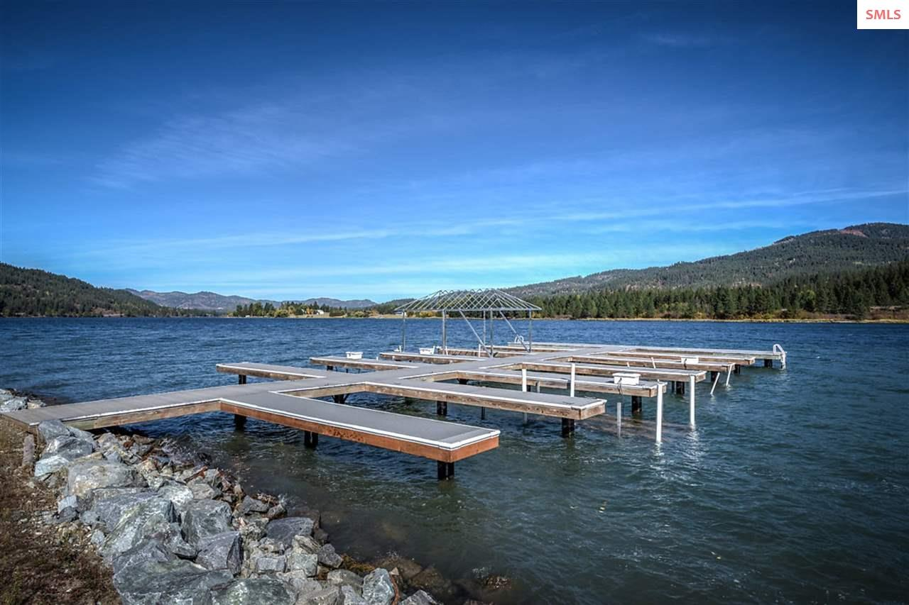 Dock and boat slip. Boat slip is included with hom