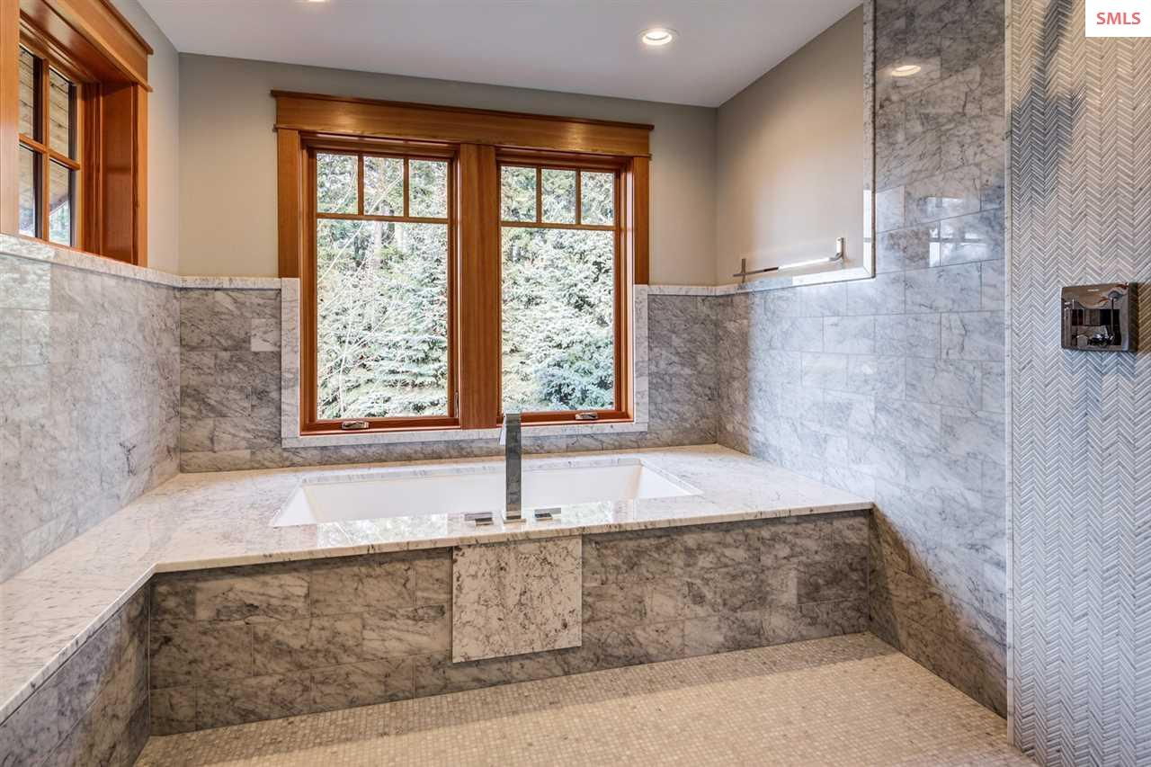 Showcasing a deep tub and rain shower