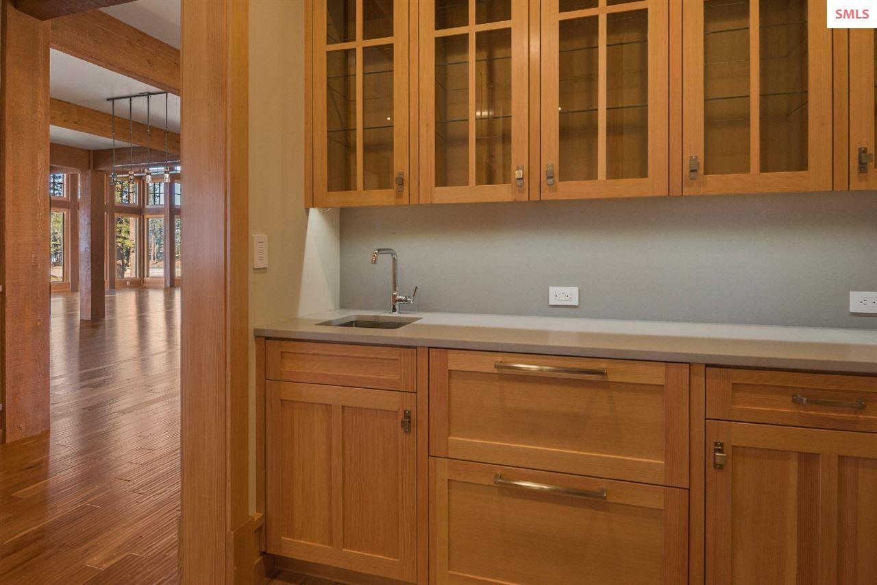 With a dishwasher, custom cabinetry & bar sink