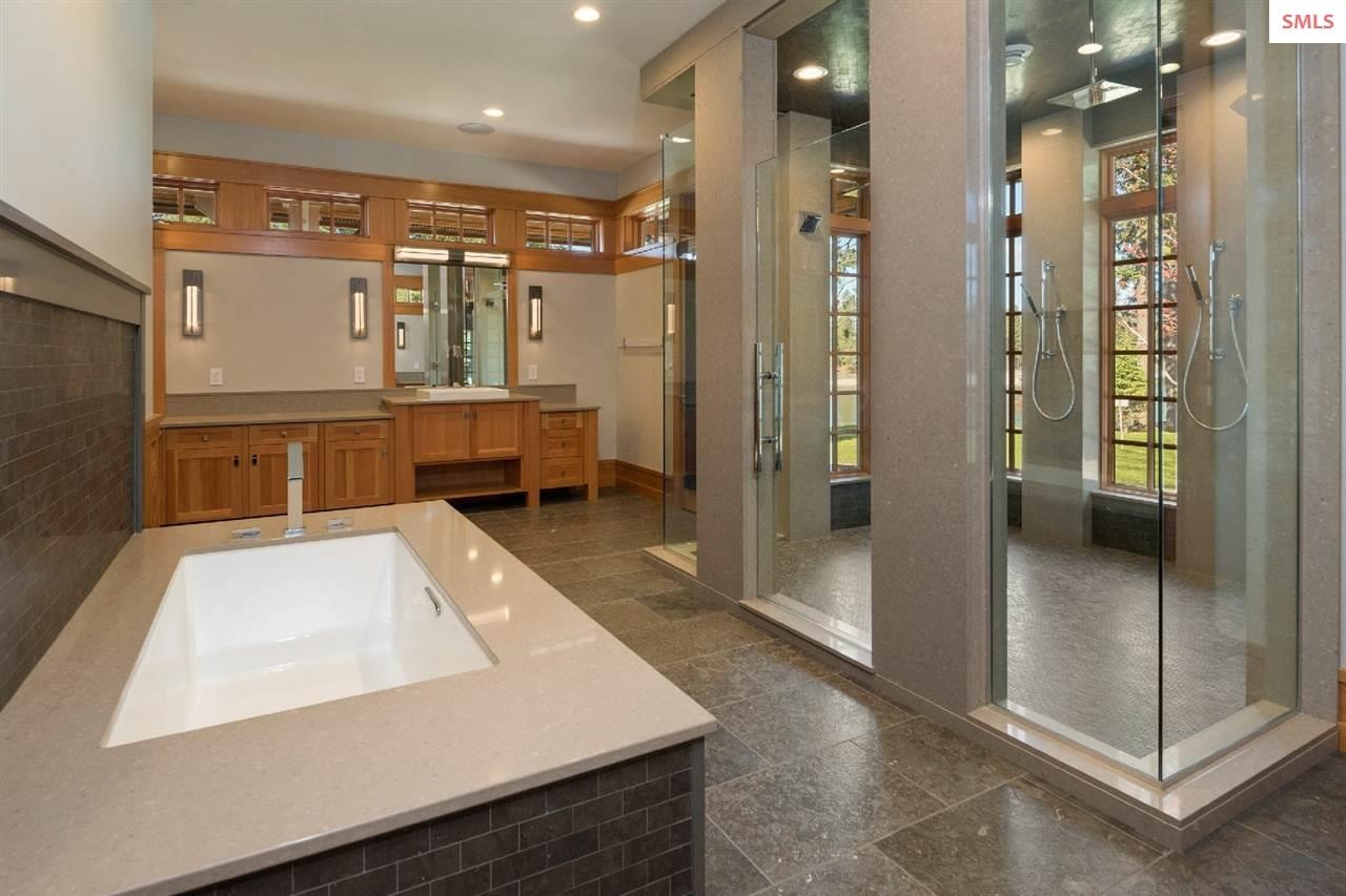 His & Hers floor plan w/central shower, tub & pati