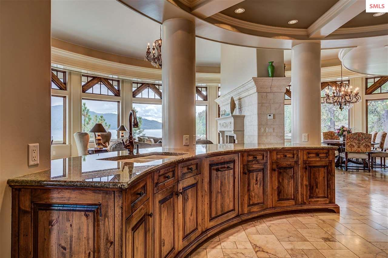 Curved bank of rustic alder cabinets with granite