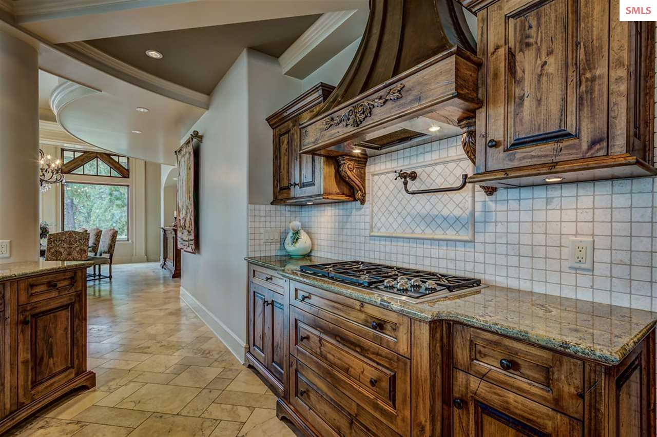 Custom rustic alder cabinetry houses the vent with