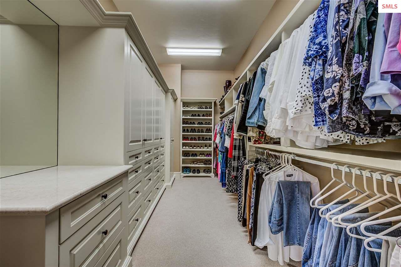Walk-in closet in master suite packs an organizati
