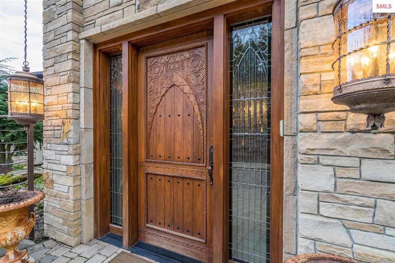 Outside doors with triple locks, custom carved, Co
