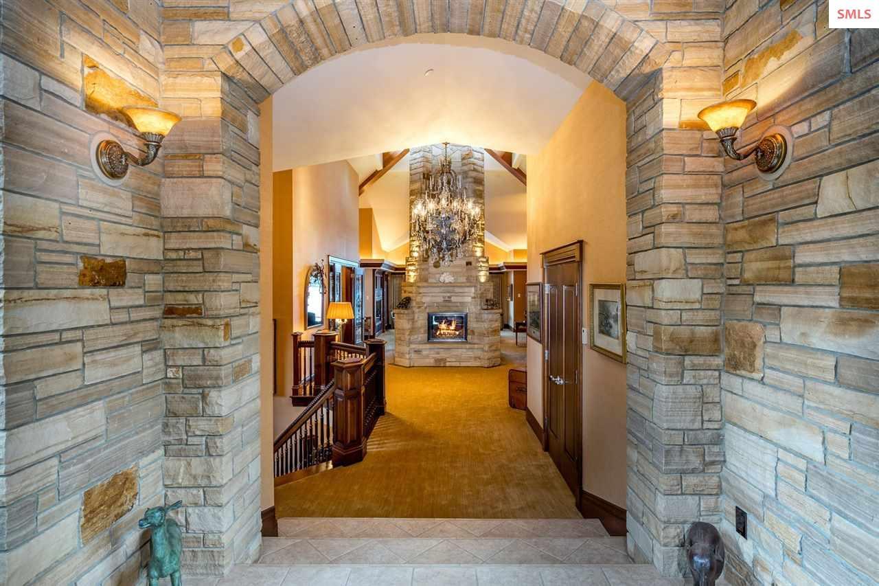Stacked stone exterior & interior entryway; Skylig