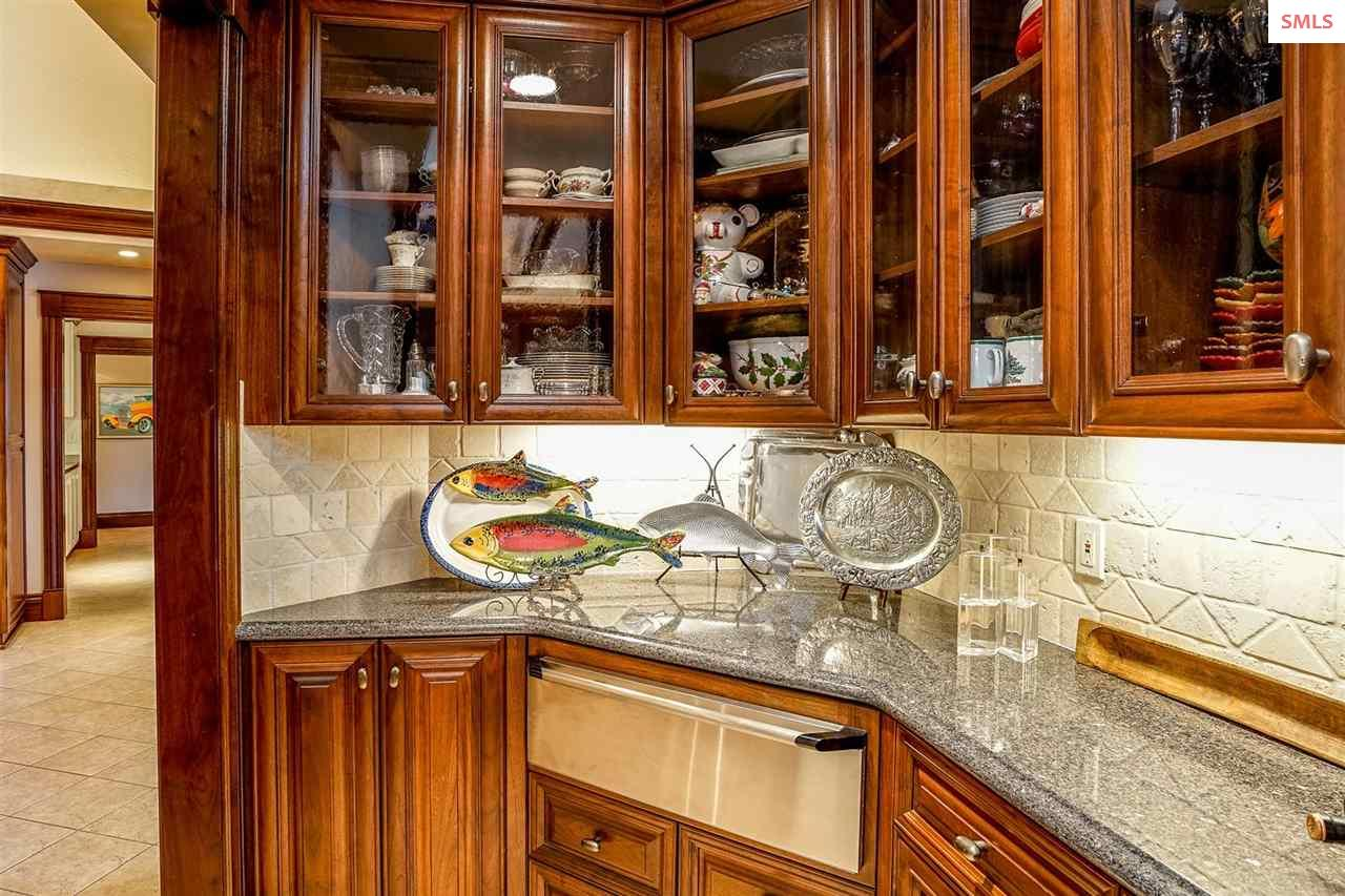 Custom black walnut cabinets, a warming drawer and