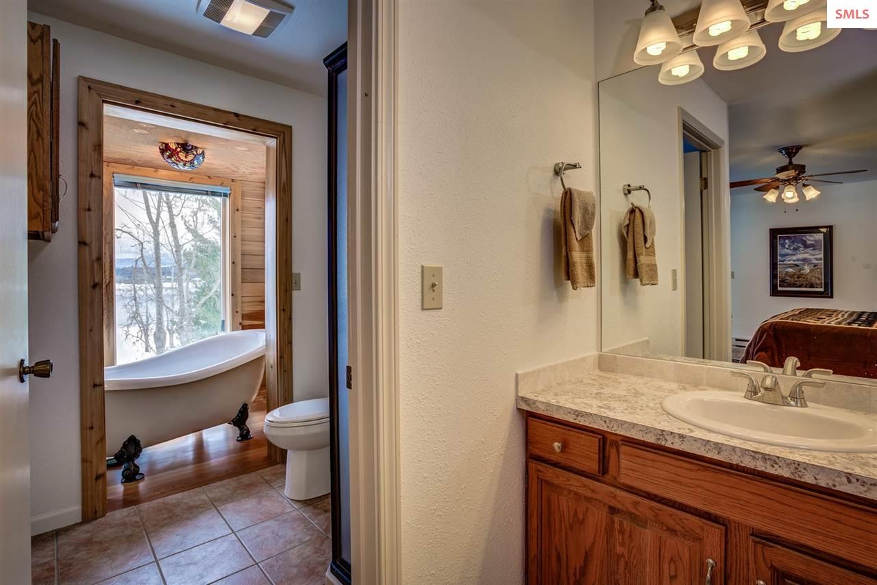 Master bathroom opens to claw foot tub