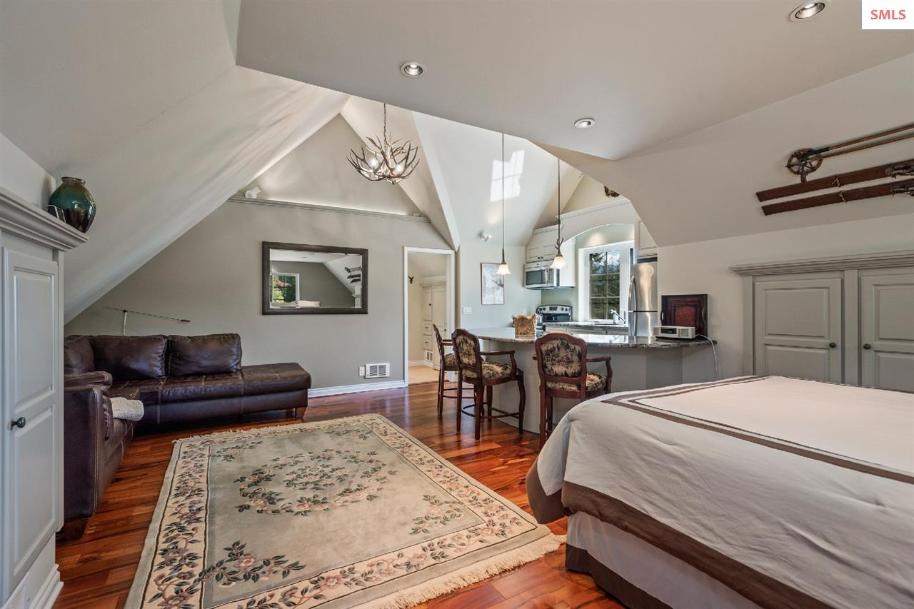 Vaulted ceilings & custom woodwork add visual inte