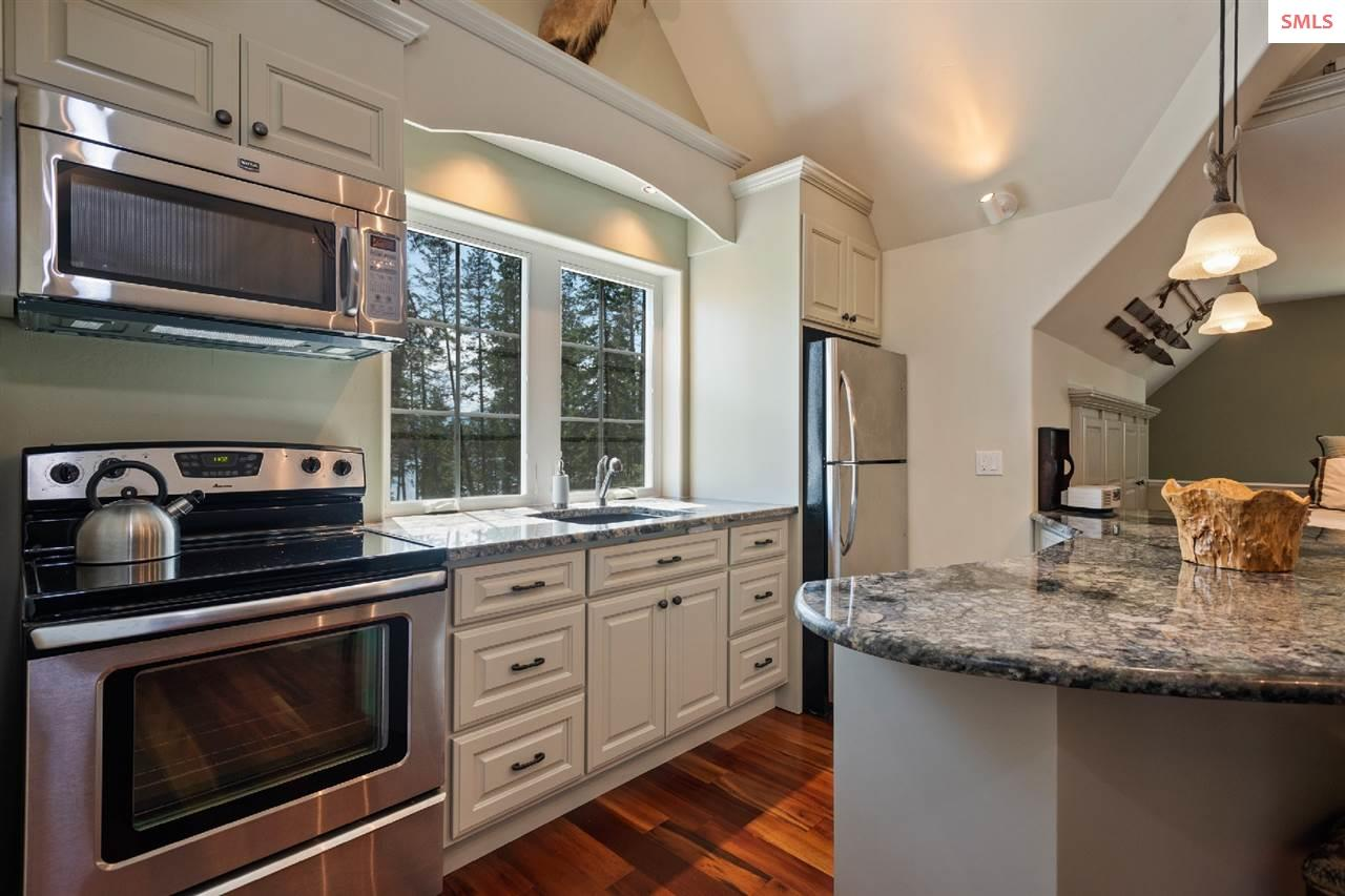 Featuring granite, stainless appliances & pendant