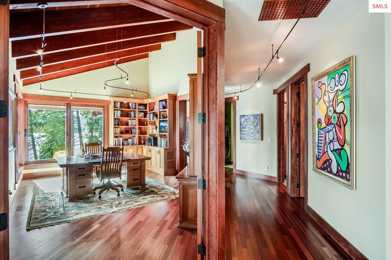 Private office features built-in cabinetry & overs