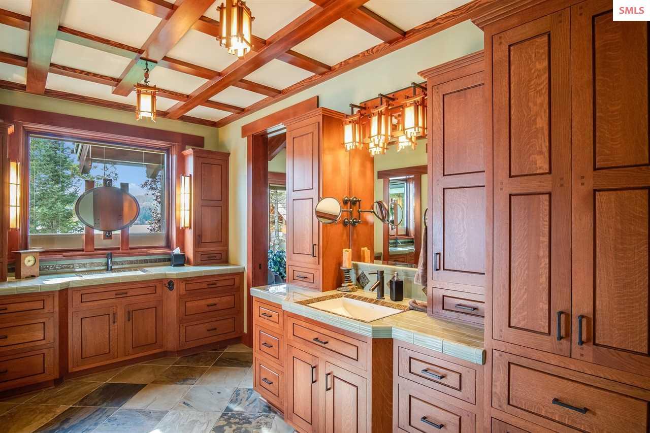 En suite bath with double vanities, quartz counter