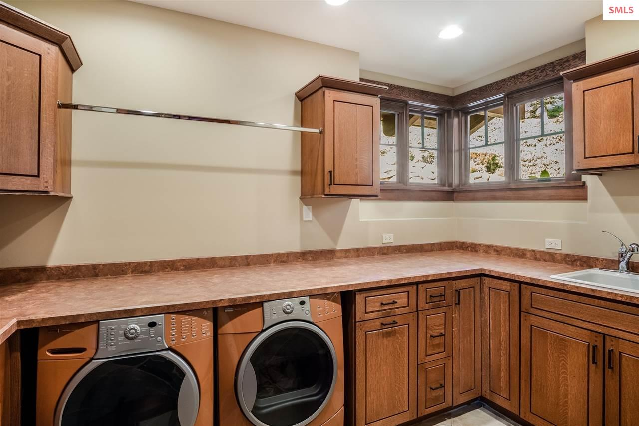 Custom cabinetry, ample counter space & deep sink