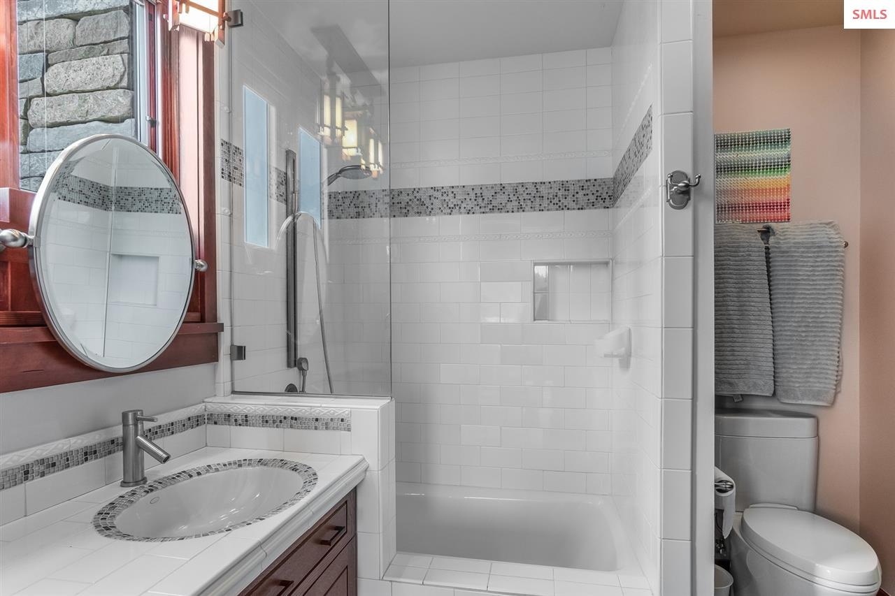 Guest room bath features walk-in shower & single v