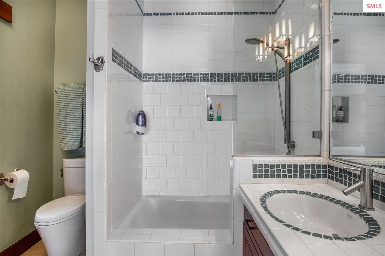 Guest bath with tub/shower combination & custom ti