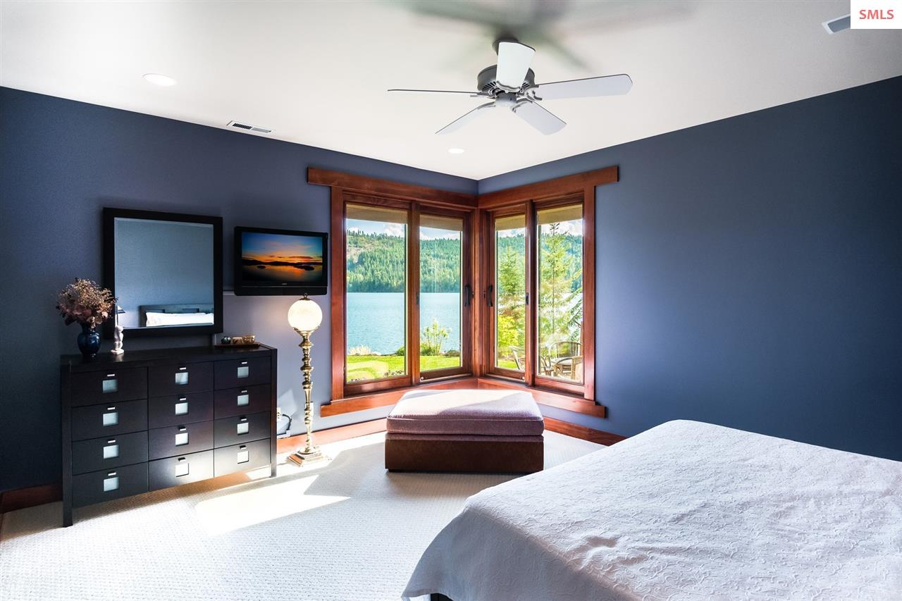 Lower level guest room with corner windows