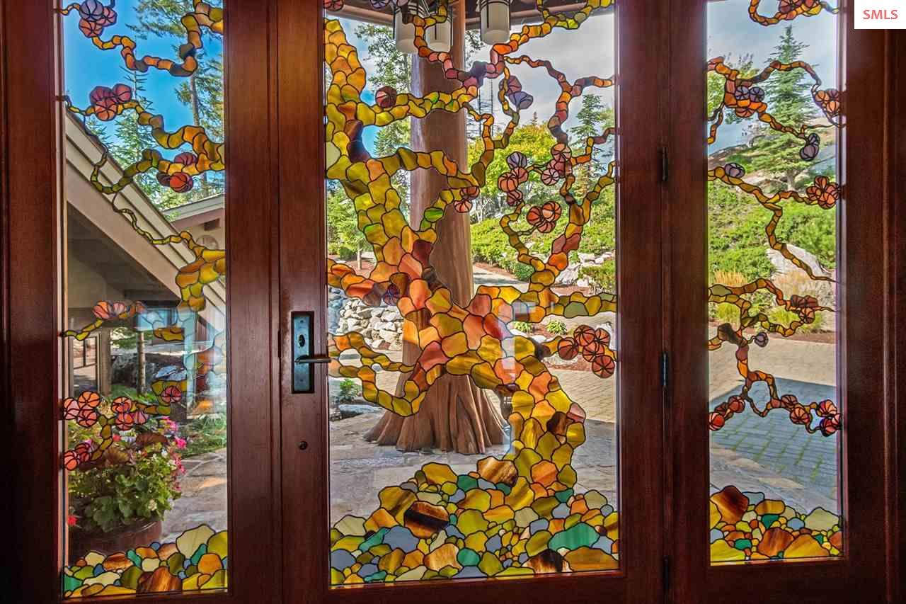 Custom entry doors with jewel-toned inlaid leaded