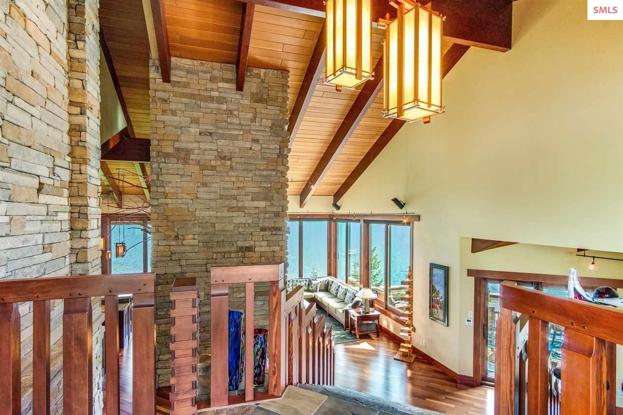Massive stone wall accents foyer inside main entry