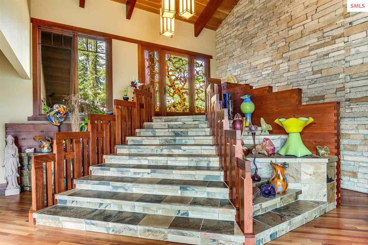 Graduated stone staircase leads the eye to the bea