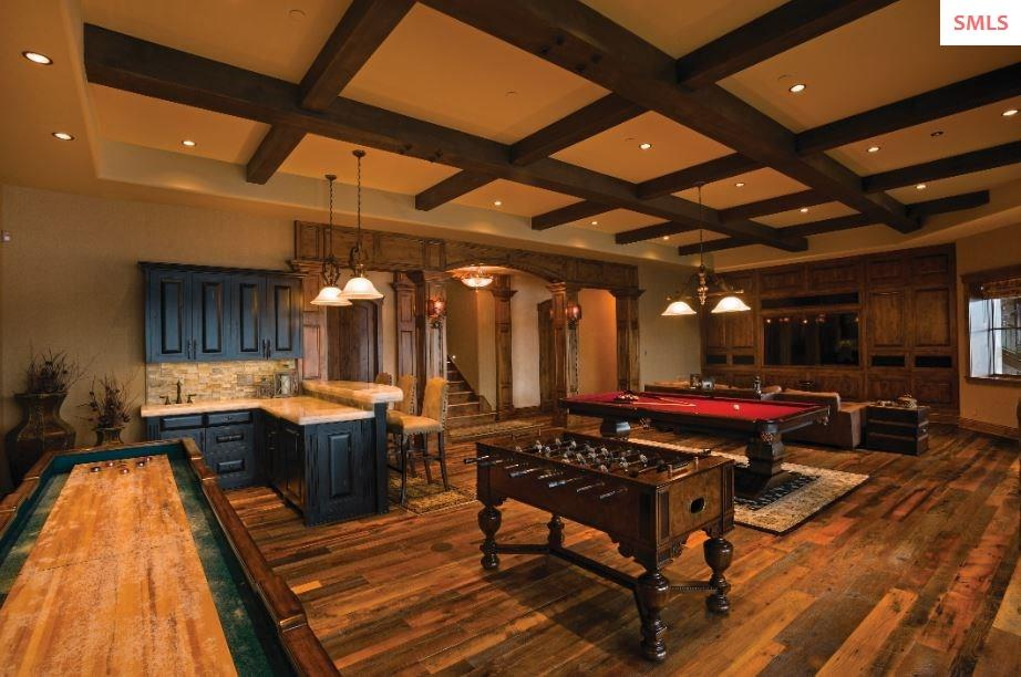Lower level rec room with game area, soda pop bar,