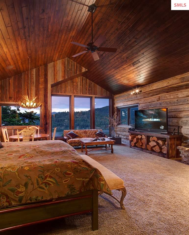 A spacious suite with fireplace, lake views, sitti