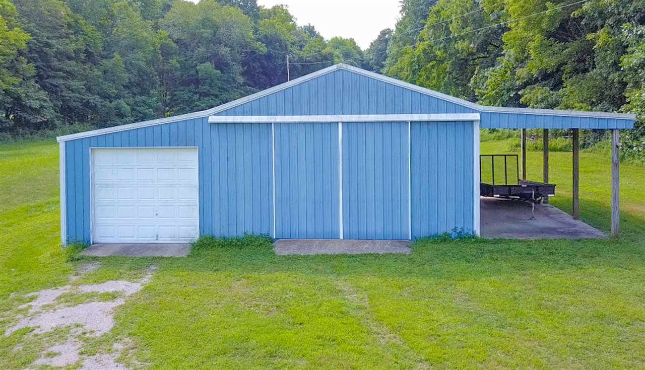 Horse stalls, garage, shed and work space