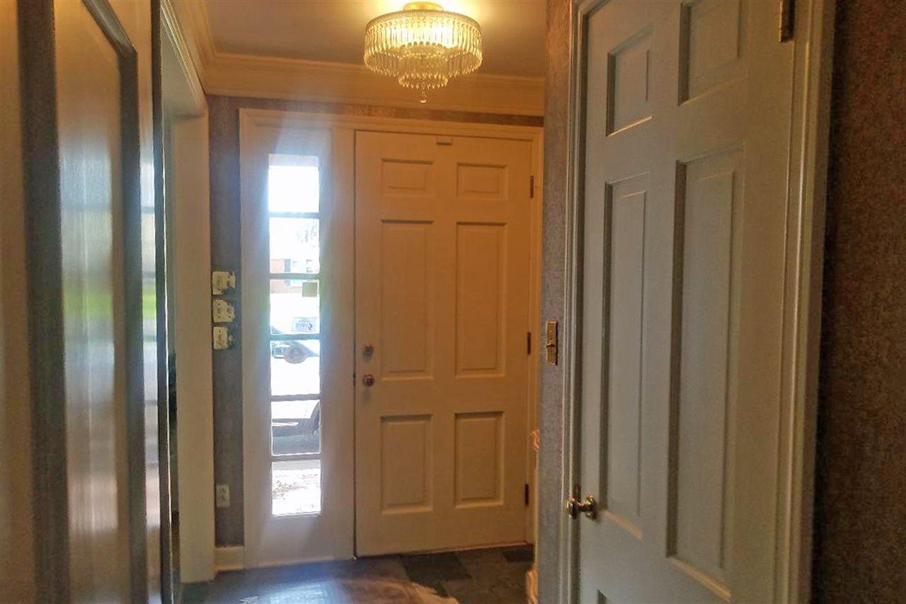 welcoming foyer with slate tile floor