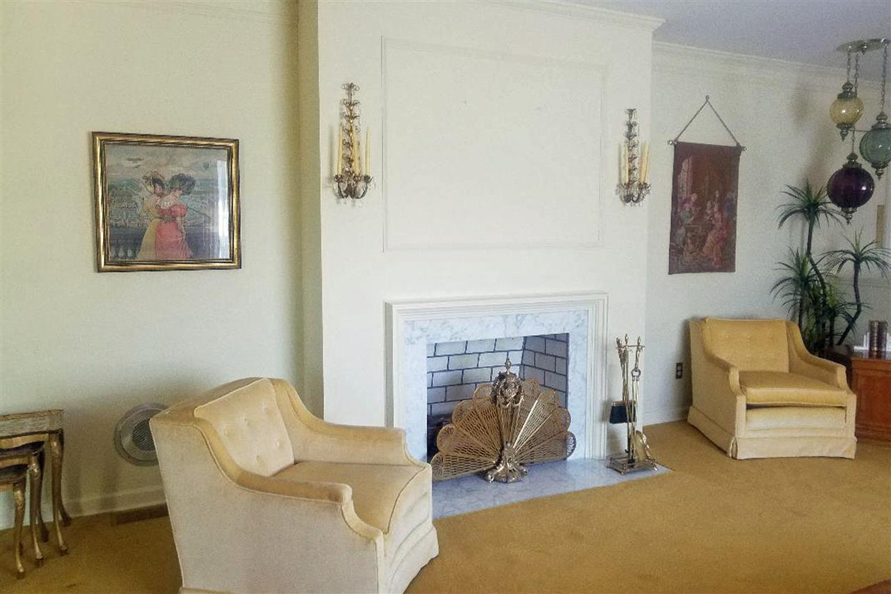 formal living room with  real wood fireplace and b