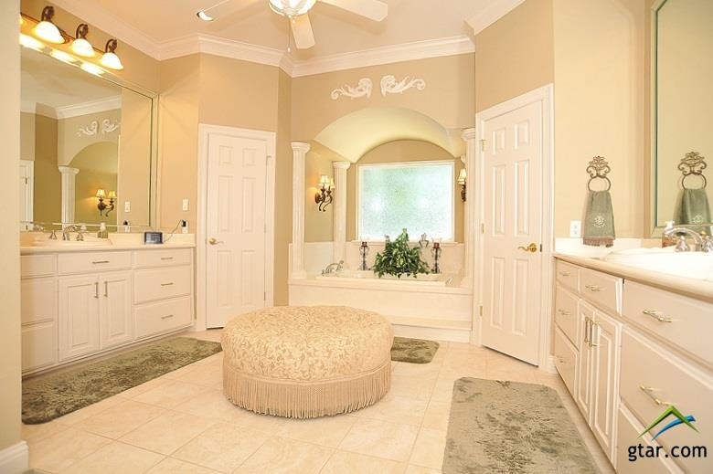 Spa like master bath. Separate vanities, jetted tu