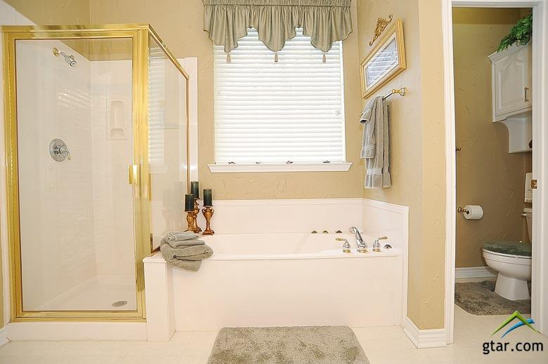 Very nice size master bathroom that is located in