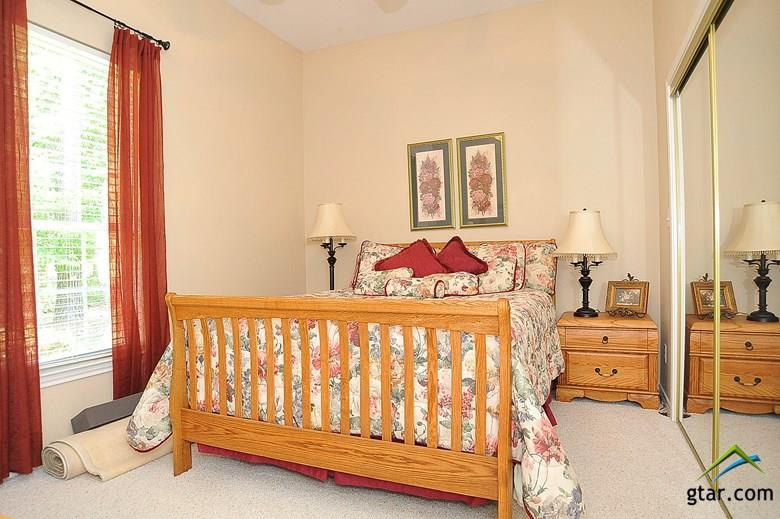 Large guest bedroom is a very comfortable size.