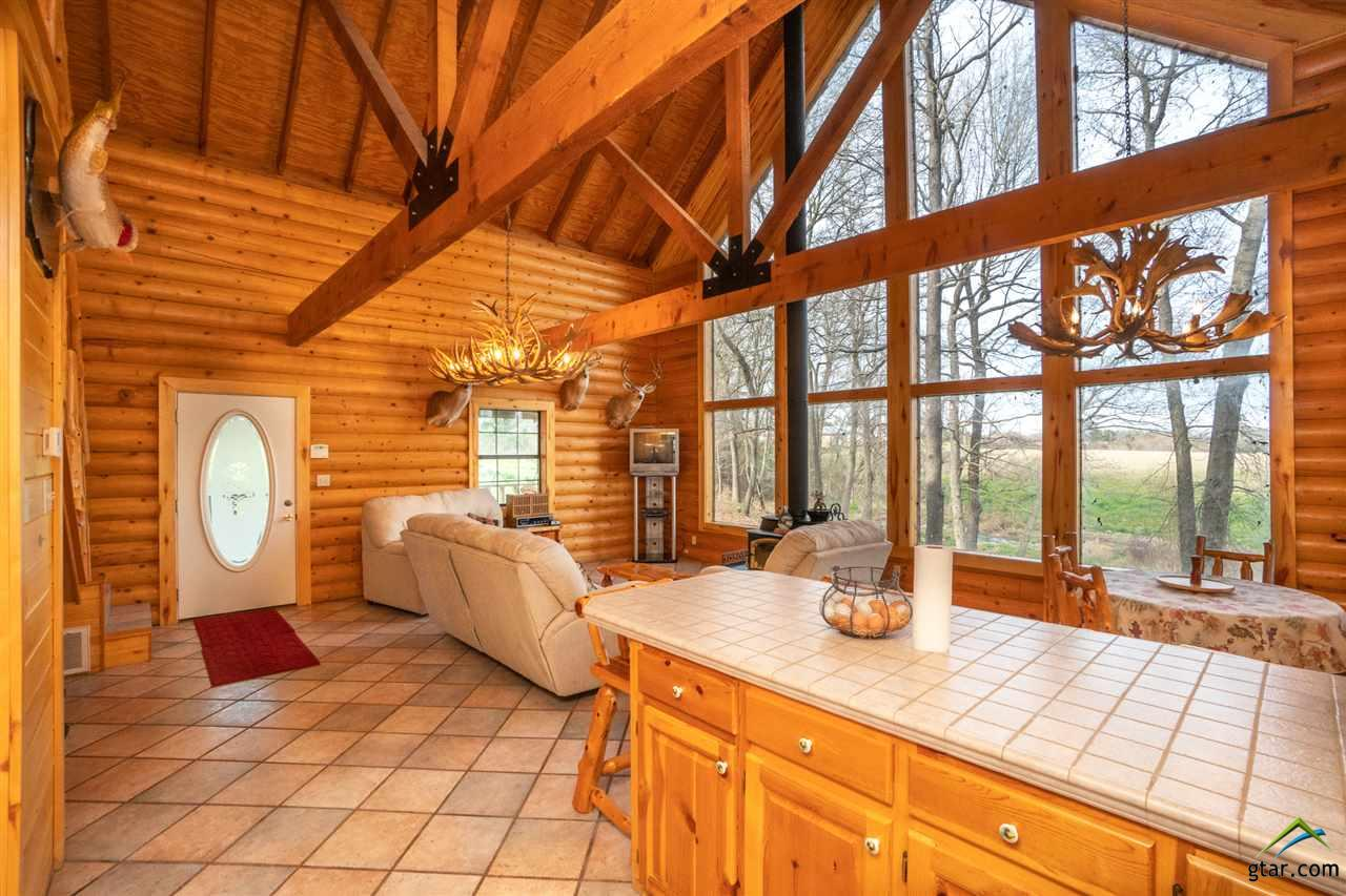 LARGE windows overlooking the lake and property.