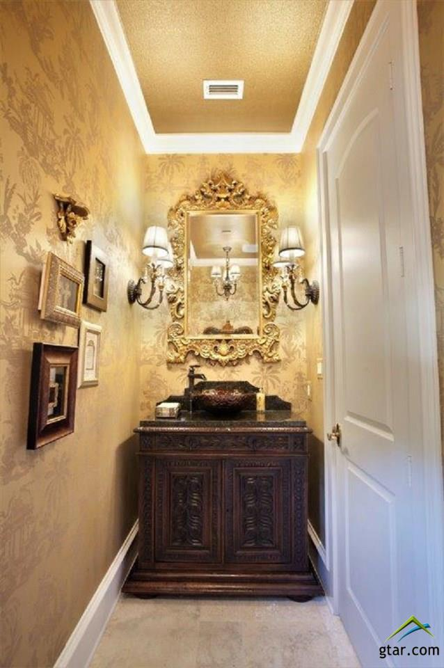 JEWEL-BOX GUEST POWDER ROOM WITH ANTIQUE VANITY.