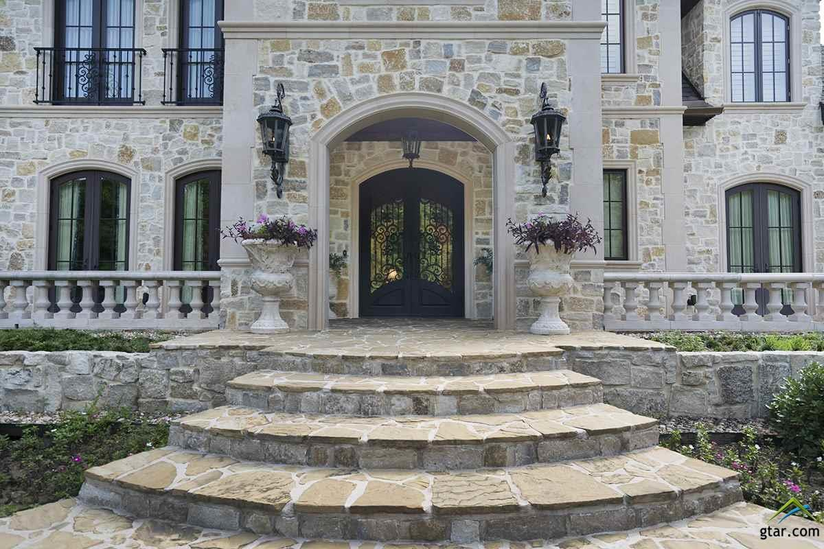 CAST STONE ACCENTS, STEPS & WALKWAYS LEAD TO DOUBL