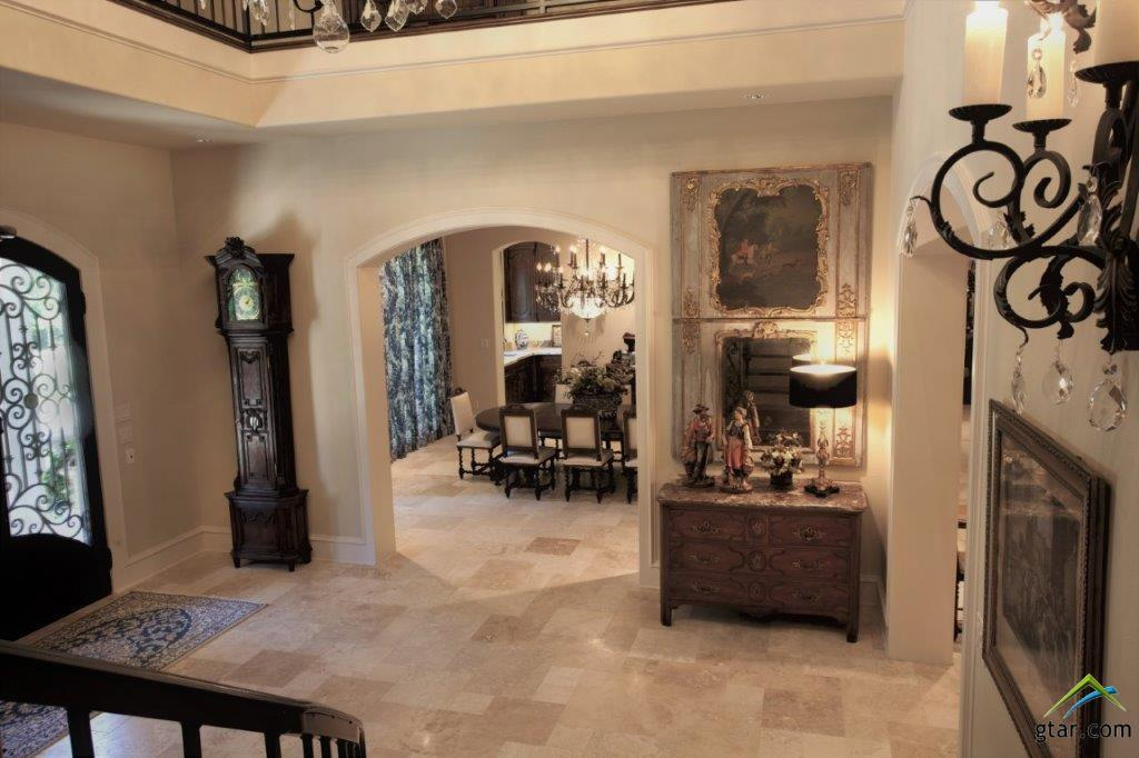 LOVELY ACCENTS, TRAVERTINE TILE FLOORS & ARCHED DO