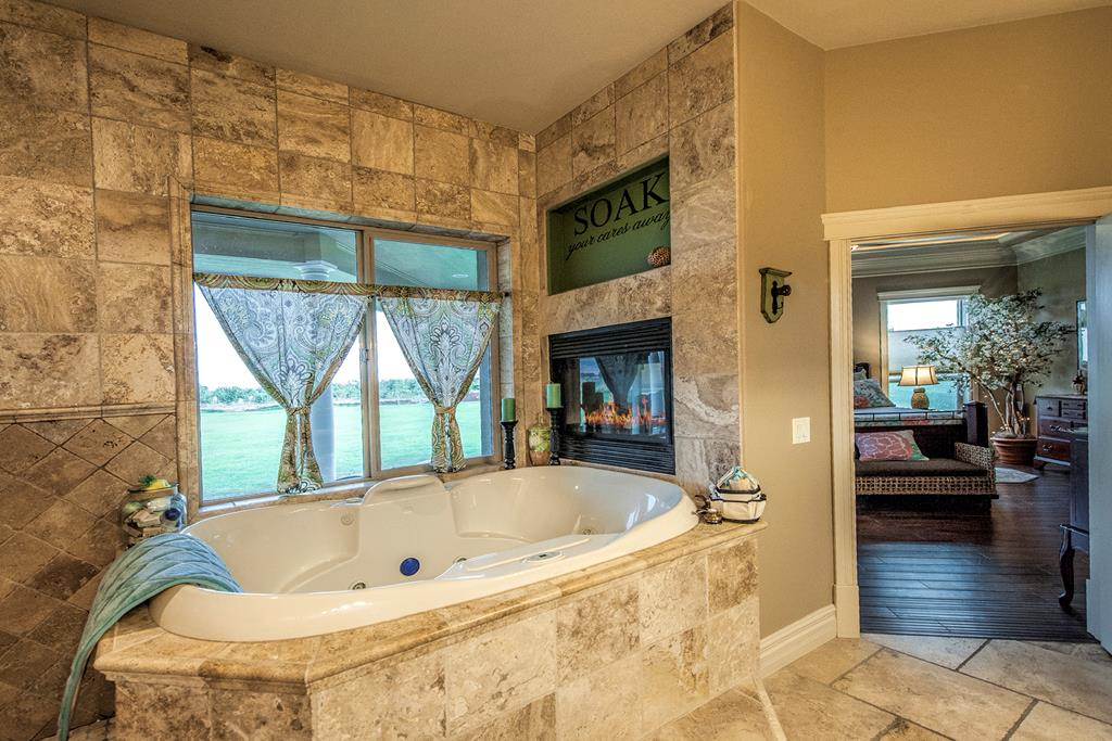 jetted tub by bathrooom fireplace