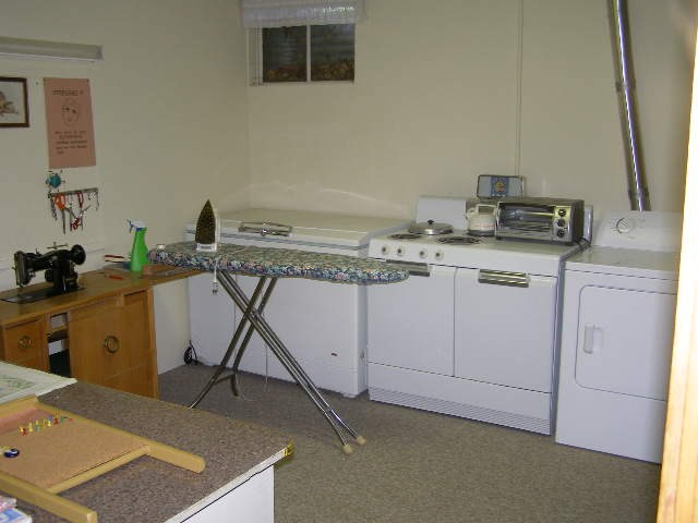 Nice large laundry and crafts room in Basement