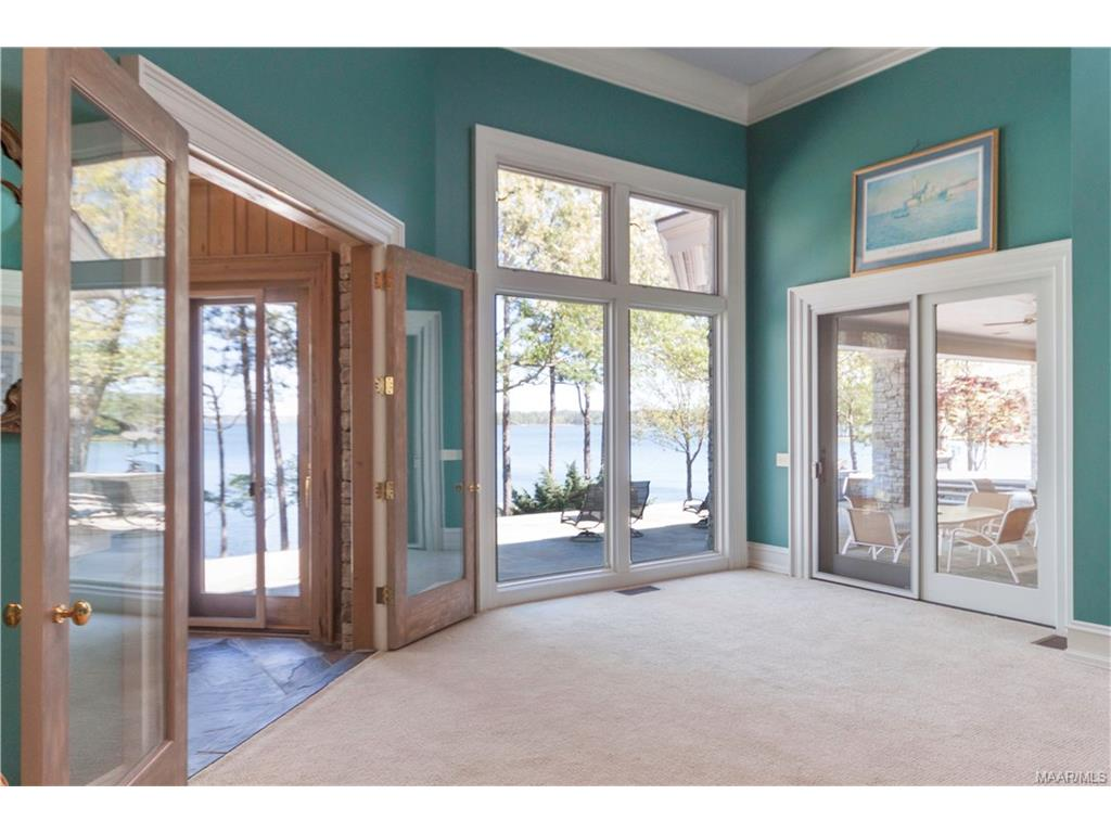 Master bedroom with Sunroom on left and patio acce
