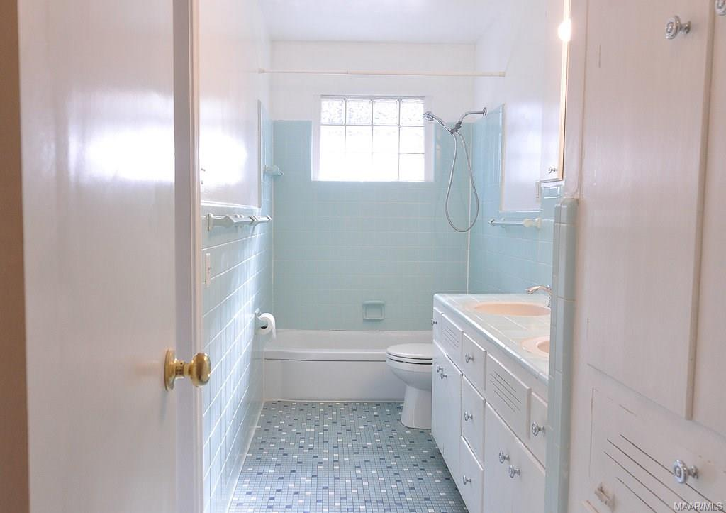 Large hall bathroom with double sinks