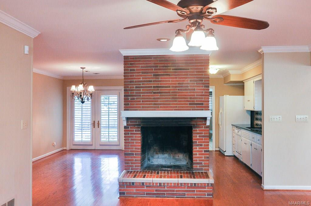 Beautiful fireplace. Behind are the dining room an