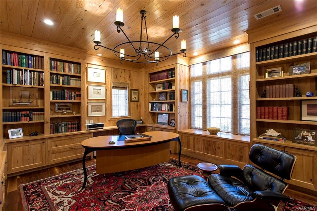 Study with Walnut Floors and Built in Bookcases