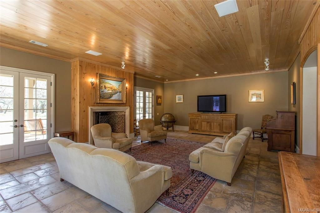 Large Den with Cypress Ceiling and Concrete Pavers