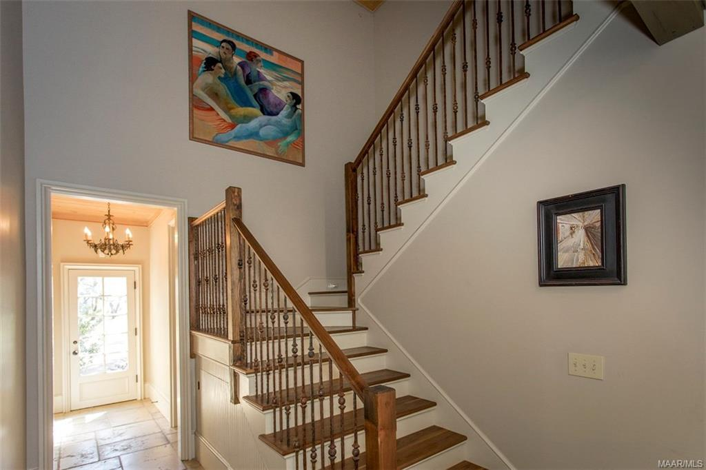 Staircase leads upstairs to Theater, Game Room and