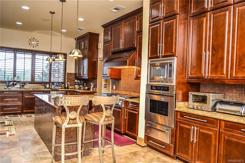 Recently updated, the kitchen has rich cabinetry,