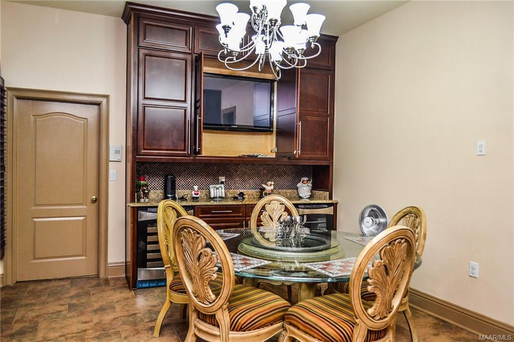 The breakfast room cabinetry houses a wine cooler,