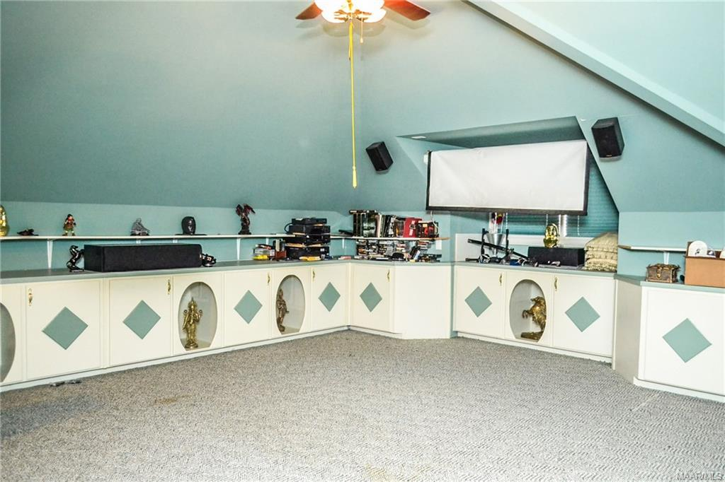 The upstairs home theatre room has enough cabinets