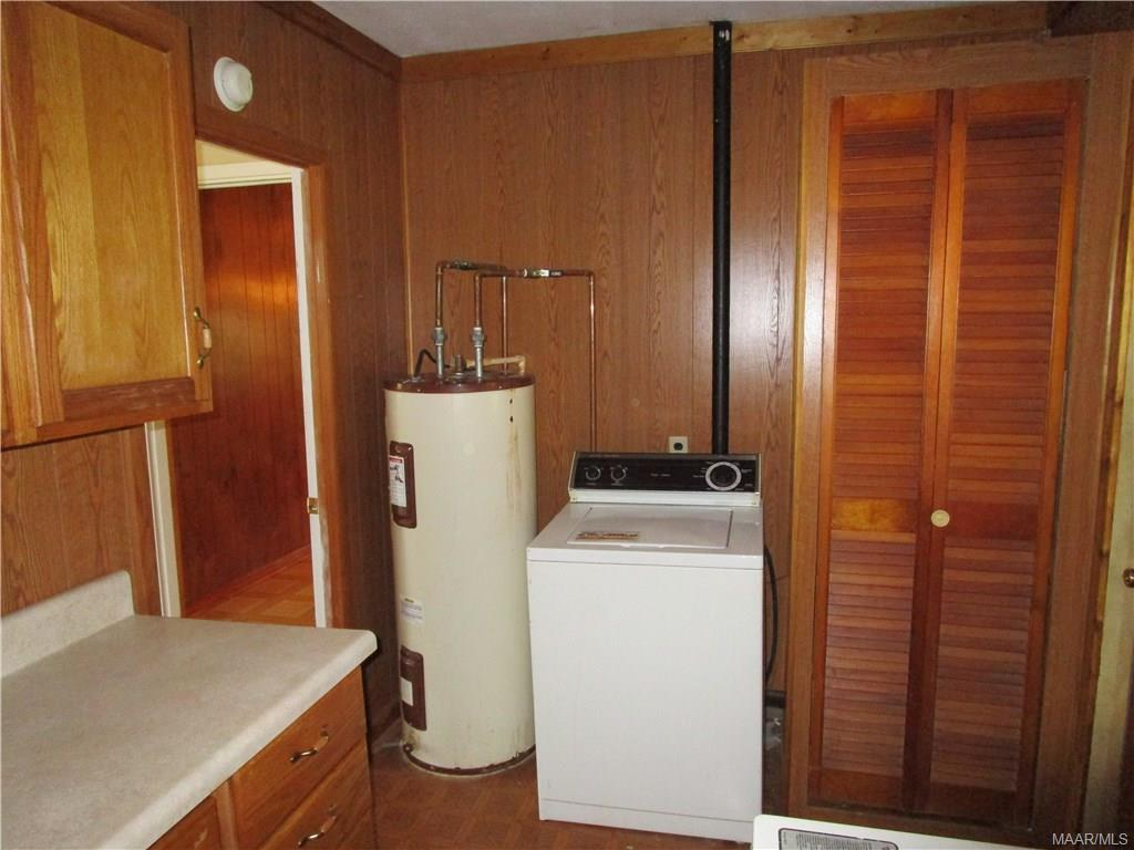 Laundry room with hot water heater