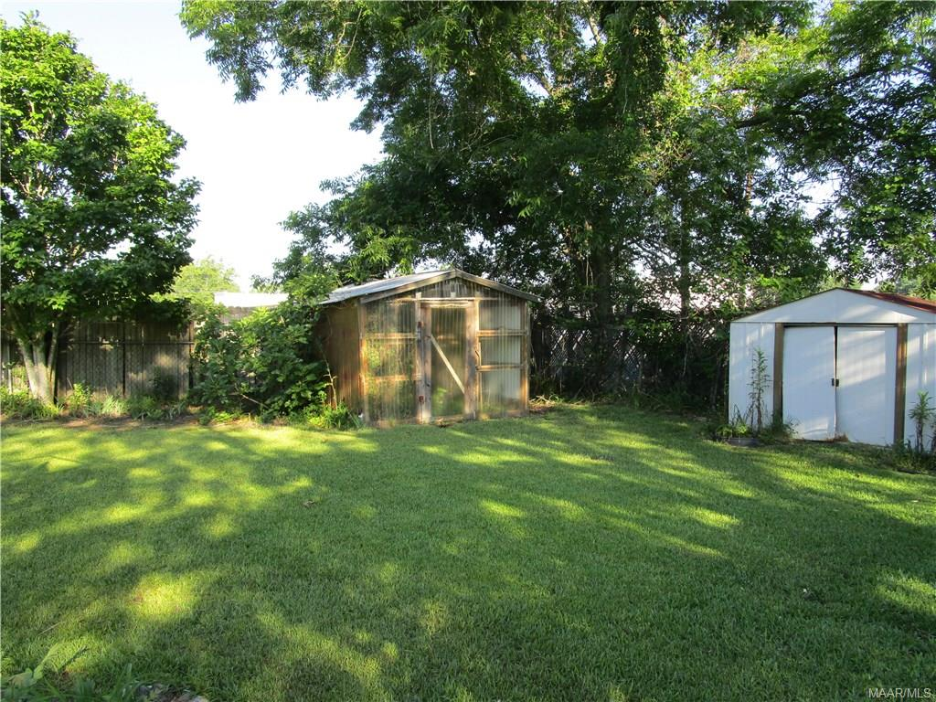 Green house and storage shed in back yard