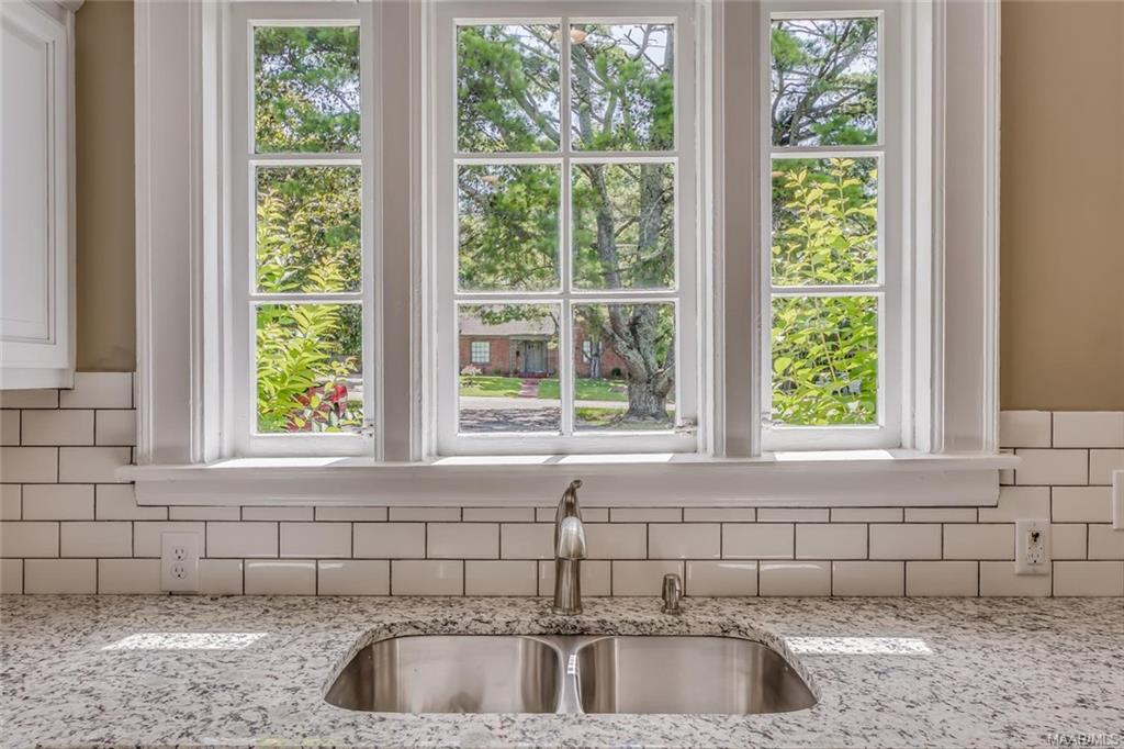 NEW sink and faucet - love the window over the sin
